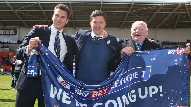 Wigan Athletic chairman David Sharpe, manager Gary Caldwell and owner Dave Whelan celebrate promotion