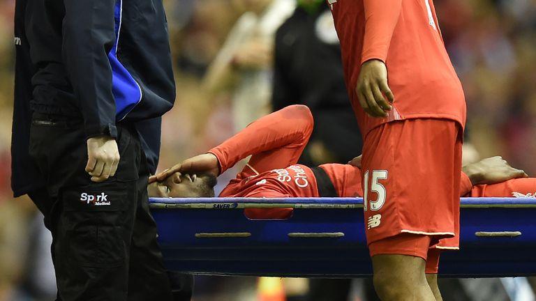 Liverpool's English striker Daniel Sturridge (R) looks at Liverpool's Belgian striker Divock Origi as he is