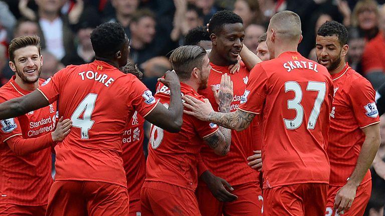 Liverpool's Belgian striker Divock Origi (4R) celebrates scoring his team's fourth goal