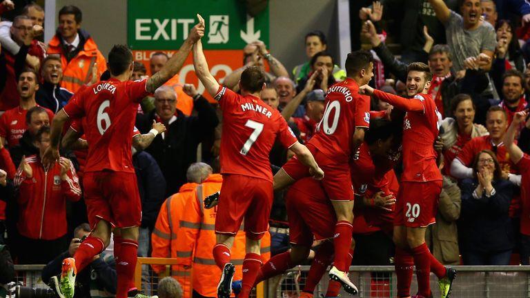 Liverpool players celebrate following Divock Origi's opening goal