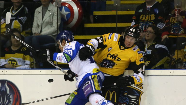 Coventry Blaze's Drew Fisher (left) and Nottingham Panthers' Geoff Waugh battle along the boards