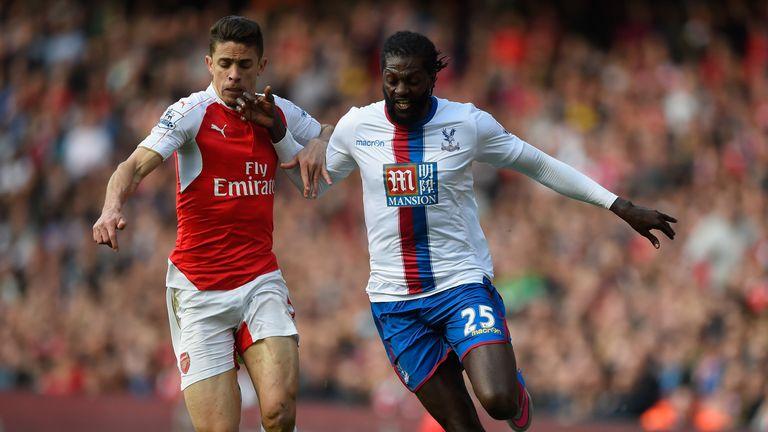 Emmanuel Adebayor of Crystal Palace is challenged by Gabriel Paulista of Arsenal