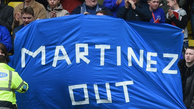 Everton supporters hold a banner against Roberto Martinez Manager of Everton