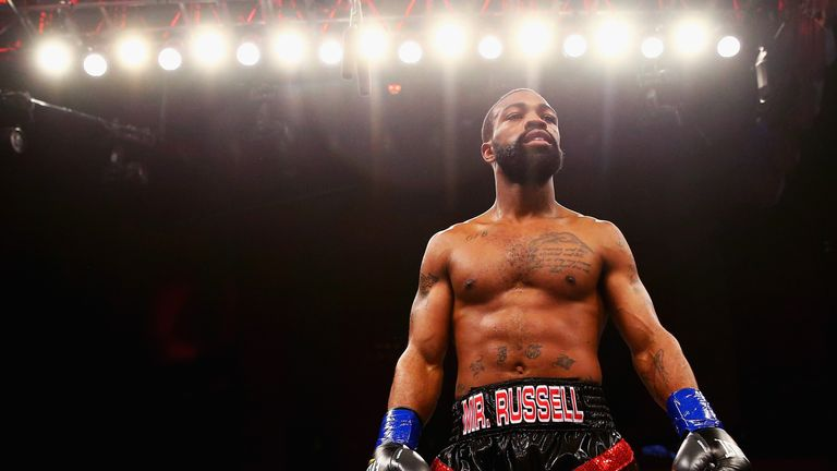 Russell Jr. celebrates after the second-round stoppage