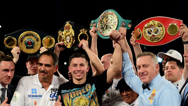 Gennady Golovkin poses with his belts after his second-round TKO of Dominic Wade in Los Angeles