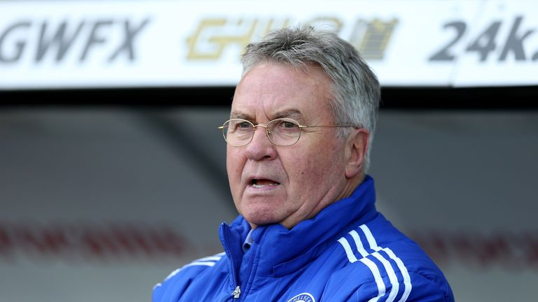 Guus Hiddink interim manager of Chelsea looks on as he side were beaten at Swansea.