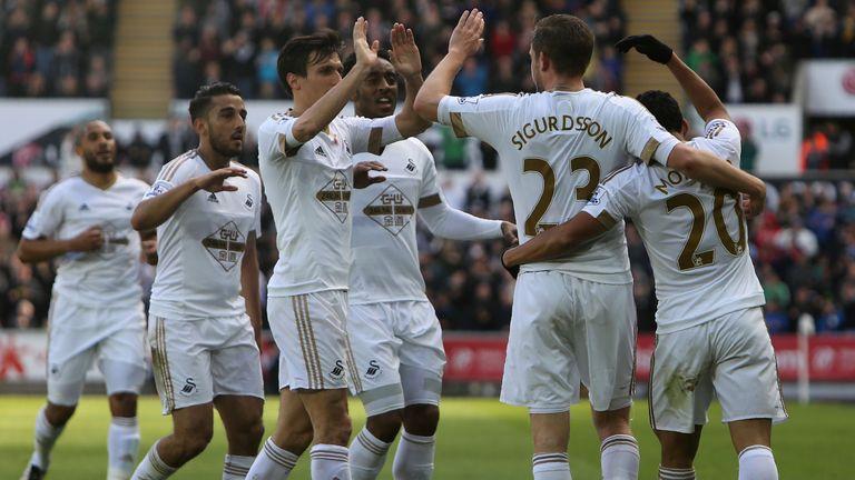 Swansea City's Icelandic midfielder Gylfi Sigurdsson celebrates scoring his team's first goal against Chelsea
