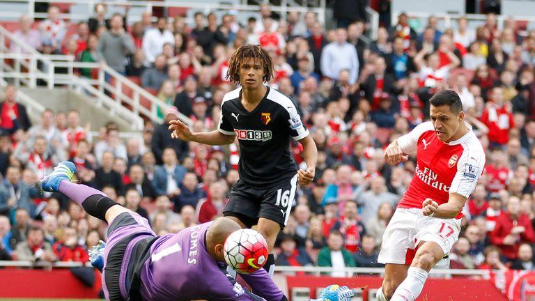 Alexis Sanchez scores past Watford goalkeeper Heurelho Gomes