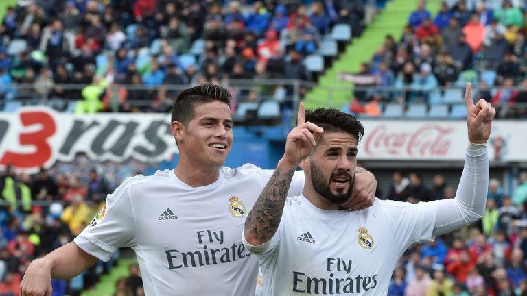 Real Madrid midfielder Isco celebrates with James Rodriguez
