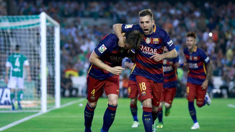 Ivan Rakitic (L) of Barcelona celebrates scoring their opening goal