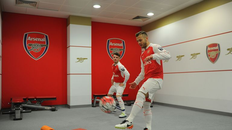 Wilshere and Dan Crowley warm up prior to kick off
