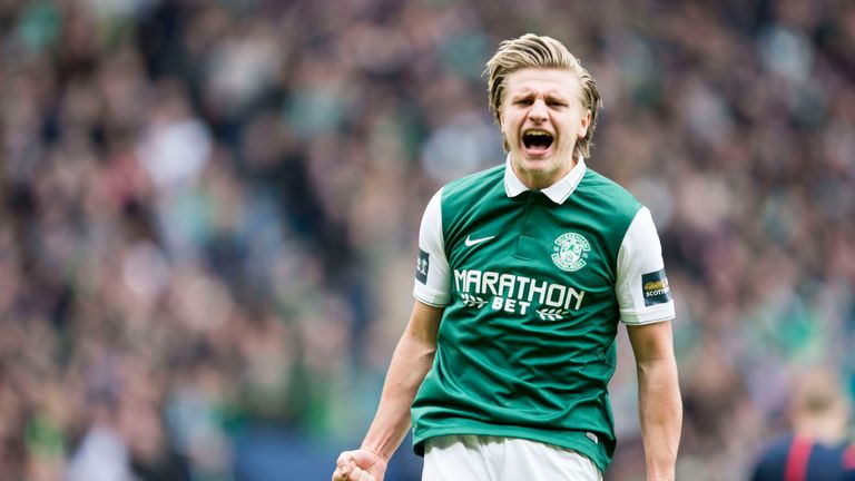 Hibernian's Jason Cummings celebrates after scoring the winning penalty