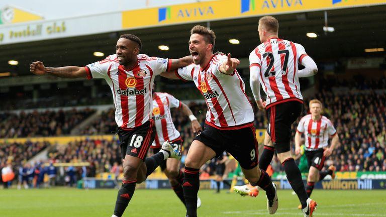 Defoe (L) celebrates another Sunderland goal