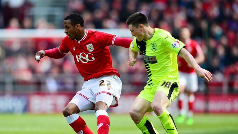 BRISTOL, ENGLAND - APRIL 30:  Jonathan Kodjia of Bristol City holds off Joe Lolley of Huddersfield Town during the Sky Bet Championship match between Brist