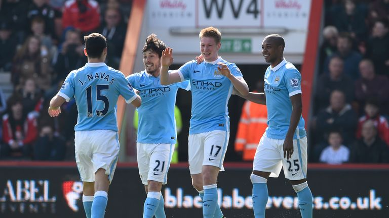 Kevin de Bruyne (2nd R) of Manchester City celebrates scoring his team's second goal with his team mates
