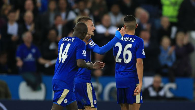 Leicester City's Jamie Vardy (centre) celebrates with Riyad Mahrez (right) and N'golo Kante after scoring his side's second goal of the game from the penal