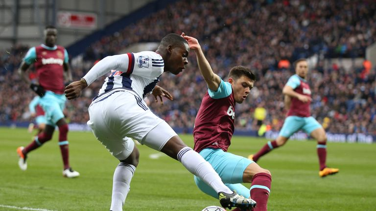 Jonathan Leko of West Bromwich Albion controls the ball under pressure of Aaron Cresswell of West Ham United during the