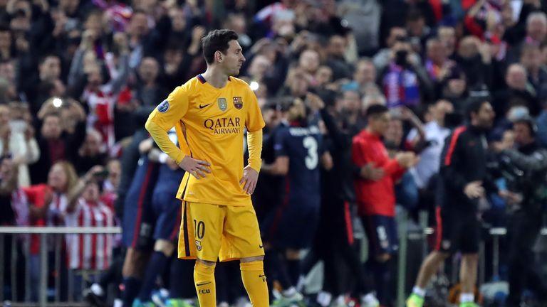 Barcelona's Lionel Messi stands dejecte after Atletico's second goal