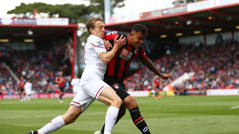 Callum Wilson of Bournemouth holds off pressure from Lucas Leiva of Liverpool