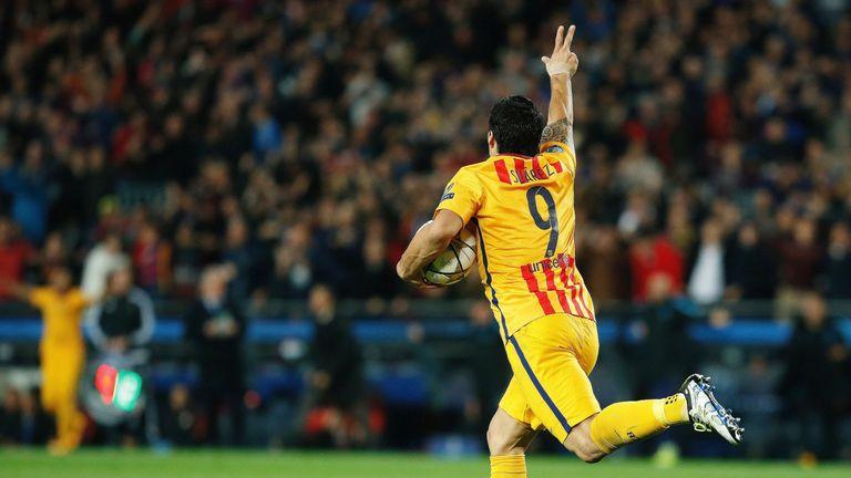 Luis Suarez celebrates his equaliser for Barcelona at the Nou Camp