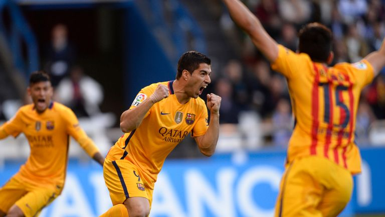 Barcelona's Luis Suarez (C) celebrates after scoring against Deportivo