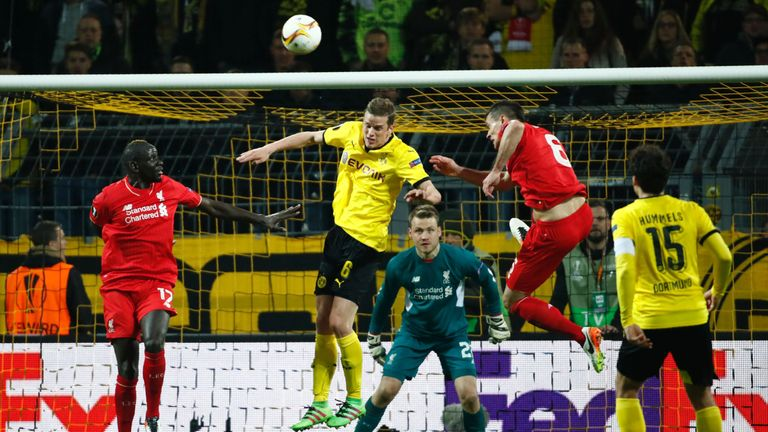 Mamadou Sakho, Sven Bender and Dejan Lovren vie for the ball during the Europa League quarter-final, first-leg match Borussia Dortmund and Liverpool
