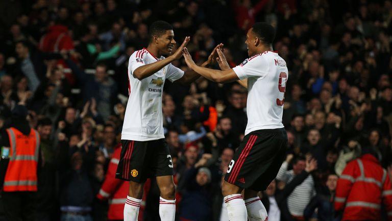 LONDON, ENGLAND - APRIL 13:  Marcus Rashford of Manchester United celebrates scoring the opening goal with Anthony Martial of Manchester United during The