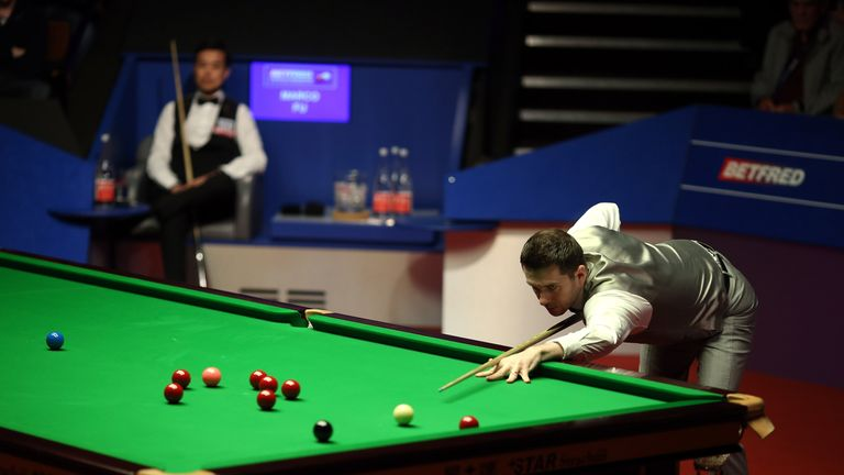 Mark Selby in action against Fu