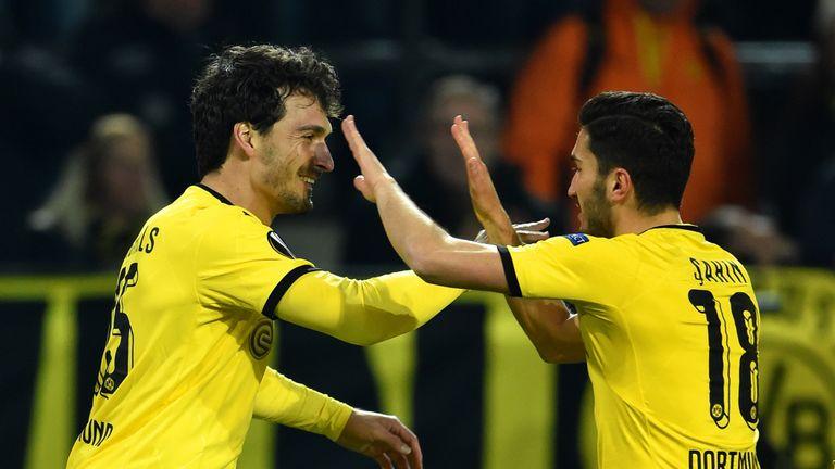 Mats Hummels of Borussia Dortmund celebrates with Nuri Sahin