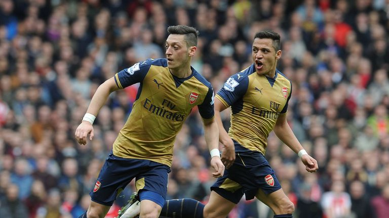 Mesut Ozil and Alexis Sanchez during the Premier League match between West Ham United and Arsenal at The Boleyn Ground, on 9th April 2016