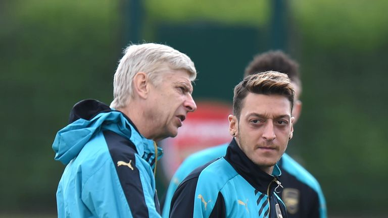 Ozil says he's determined to win the Premier League title for Arsenal manager Arsene Wenger