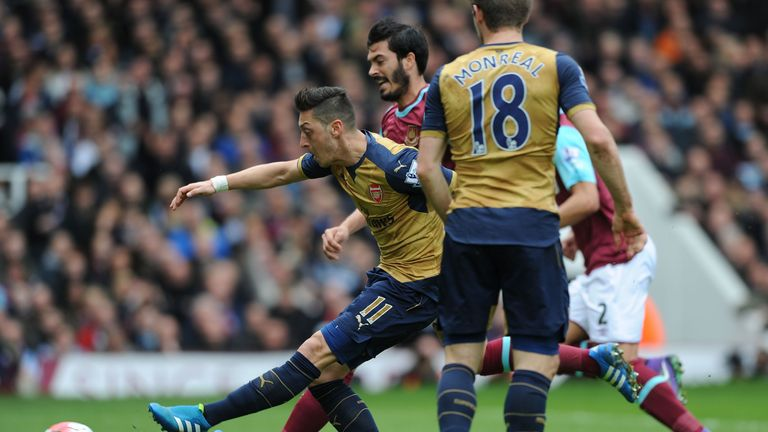 Mesut Ozil opens the scoring for Arsenal at West Ham