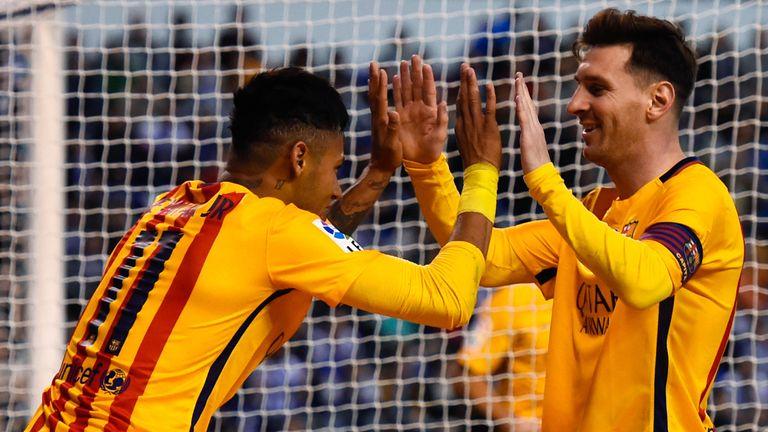 Neymar celebrates with team-mate Lionel Messi