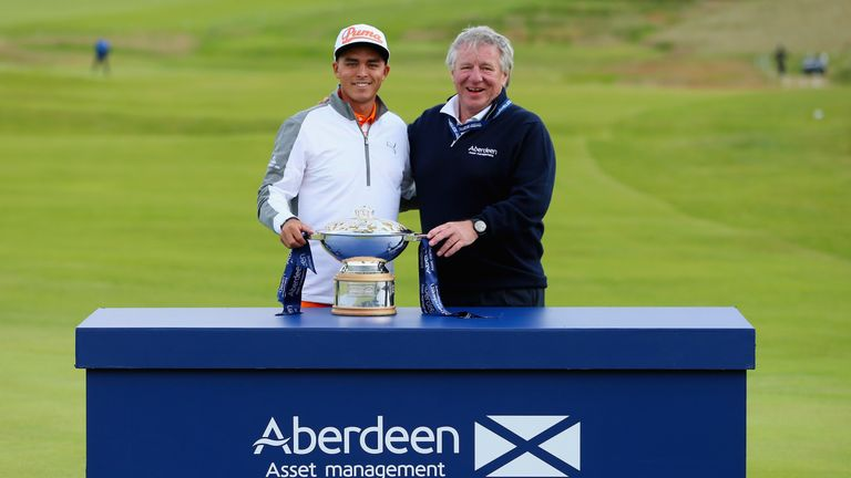 Rickie Fowler celebrates with the trophy alongside Martin Gilbert of Aberdeen Asset Management after winning last year's Scottish Open