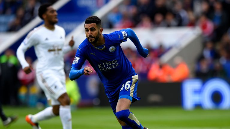 Riyad Mahrez of Leicester City celebrates scoring the opener against Swansea
