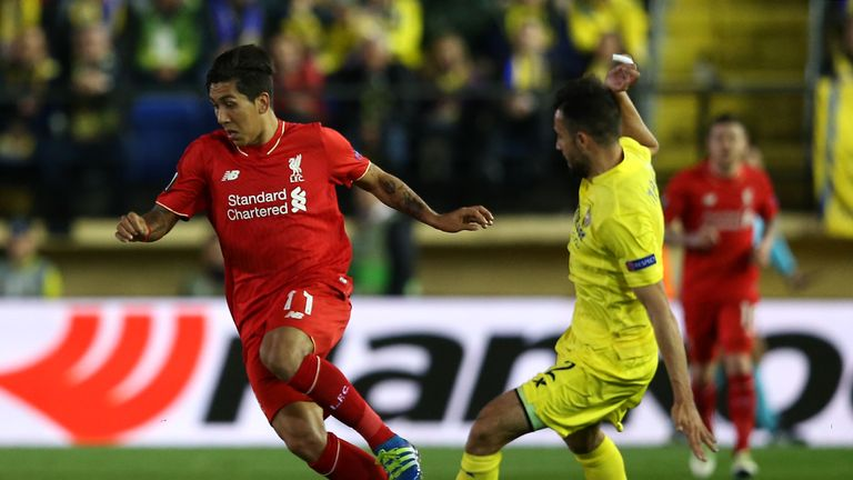 Liverpool's Roberto Firmino skips past the challenge of Mario Gaspar