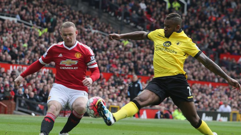Manchester United's Wayne Rooney challenges with Aston Villa's Leandro Bacuna