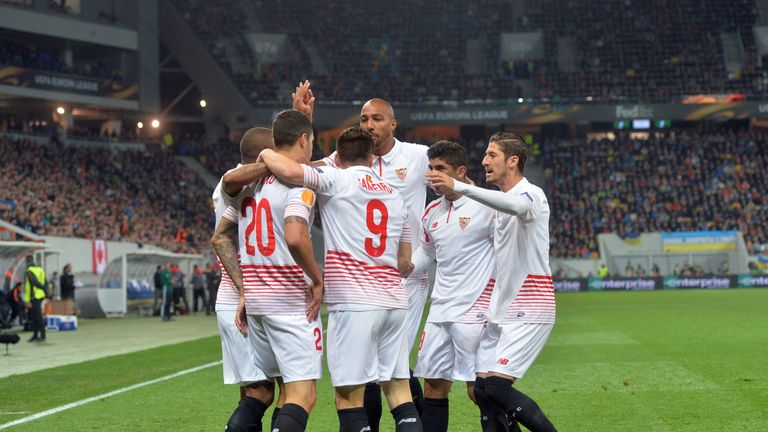 Sevillas players react after opening the scoring against FC Shakhtar