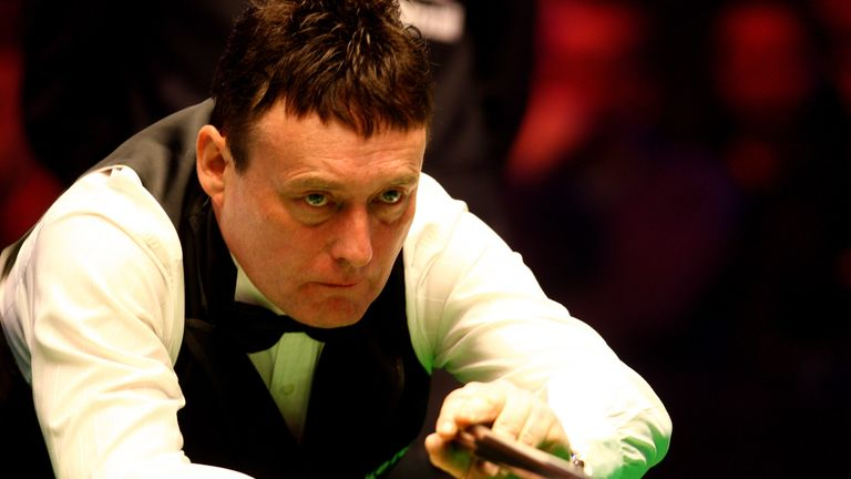 Jimmy White of England lines up a shot during his game against Mark King