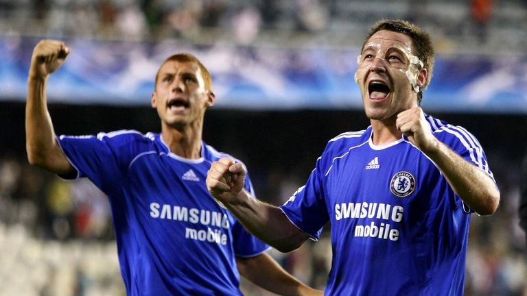 VALENCIA, SPAIN - OCTOBER 03:  John Terry of Chelsea (R) and Steve Sidwell salute the Chelsea fans after their 2-1 victory during the UEFA Champions League