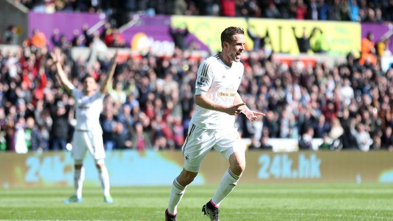 Gylfi Sigurdsson celebrates scoring Swansea City's opener against Chelsea