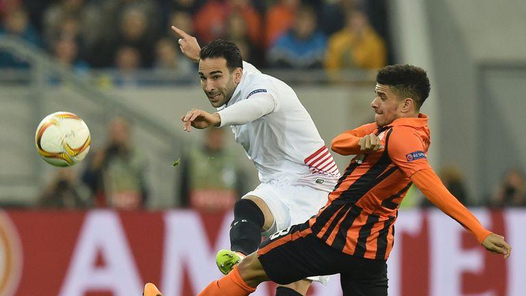 Sevilla's Adil Rami (left) takes on Taison of FC Shakhtar in the Europa League semi-final