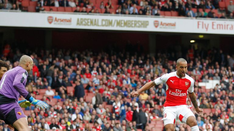 Theo Walcott turns home Arsenal's fourth in the 90th minute