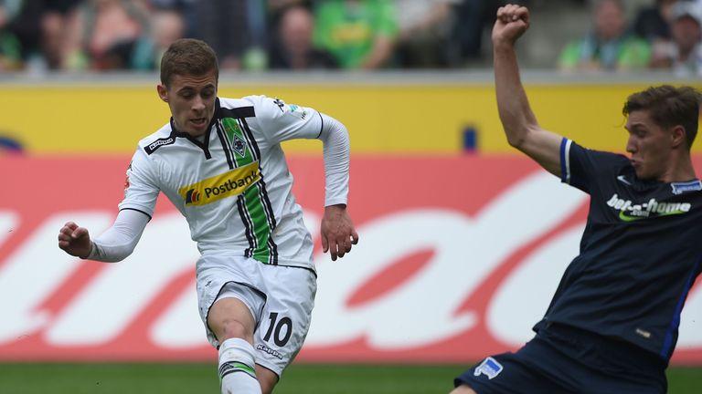 Moenchengladbach's Belgian midfielder Thorgan Hazard scores against Hertha Berlin