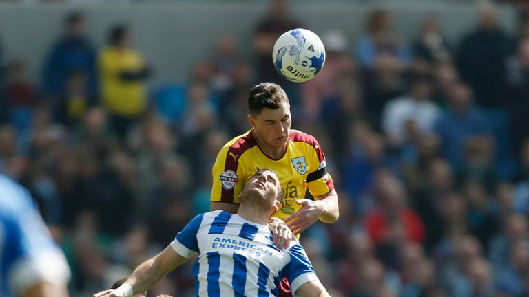 Burnley's Michael Keane and Brighton and Hove Albion's Tomer Hemed battle for the ball