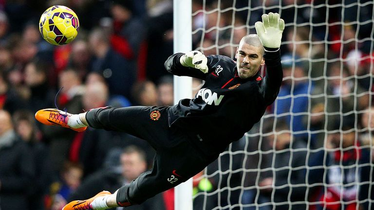 Victor Valdes warms up before a match between Manchester United and Southampton
