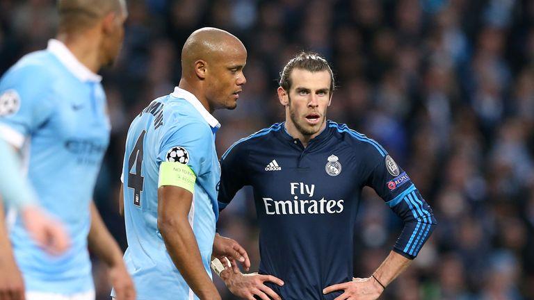 Vincent Kompany keeps tabs on Bale