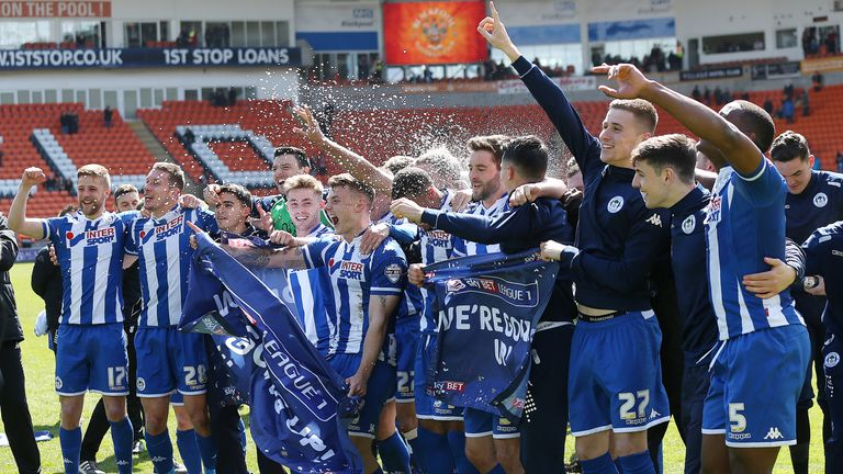 Wigan Athletic celebrate winning promotion to the Sky Bet Championship