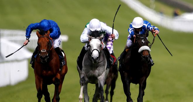 Jim Crowley and Algometer (centre) win the EBF Stallions Cocked Hat Stakes from Prize Money at Goodwood.