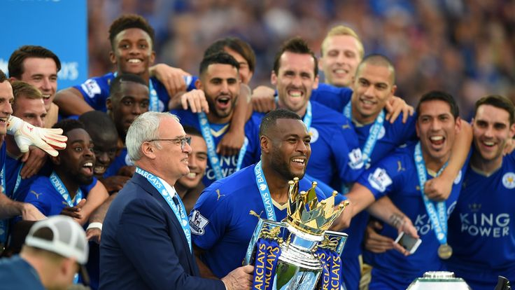 Captain Wes Morgan and manager Claudio Ranieri of Leicester City prepare to lift the Premier League Trophy after the Barclays